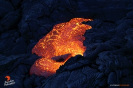 Pahoehoe oozes from the side of a tube.