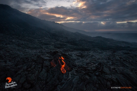 A breakout at the base of Pulama Pali pours out over the recently cooled lava field at sunrise.