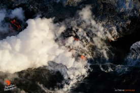 Multiple fingers of lava pour into the sea, creating a brand new black sand beach at the edge of the Kamokuna delta.