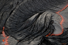 The rapidly cooling surface of a large breakout is pulled into ropey formations by the friction created by the flowing viscous molten lava beneath.