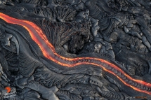 One of the many rivers of pahoehoe zigzags down Pulama Pali, creating a ribbon-like abstract through the silvery black lava field.