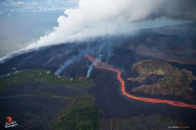 Another wave of molten lava pushes over the existing flow field on the coastal plain in Kapoho, as more home are threatened by increased activity along the northern periphery.
